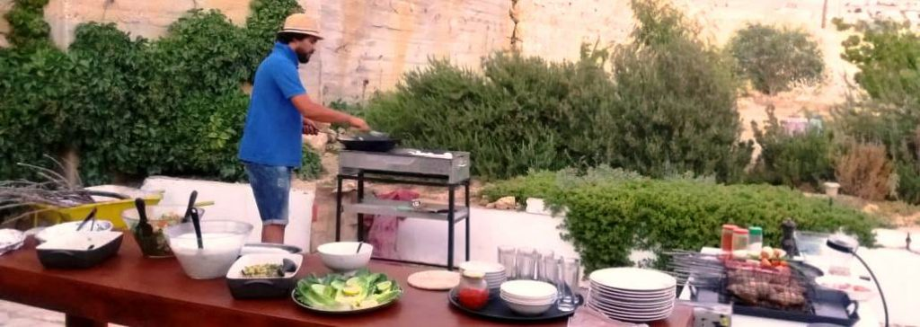 Fadi prepairing the BBQ for the guests of B&B Petra Fig Tree Villa 1