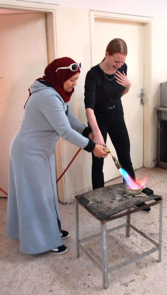 Melting the silver during the silver workshop with the Nabataean Ladies in Petra