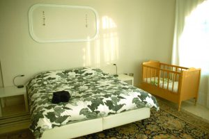 Petra family room with baby cot and twin beds in bed and breakfast Petra Fig Tree Villa.