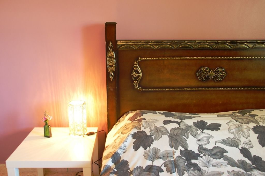 The bed in the Rosemary room with light