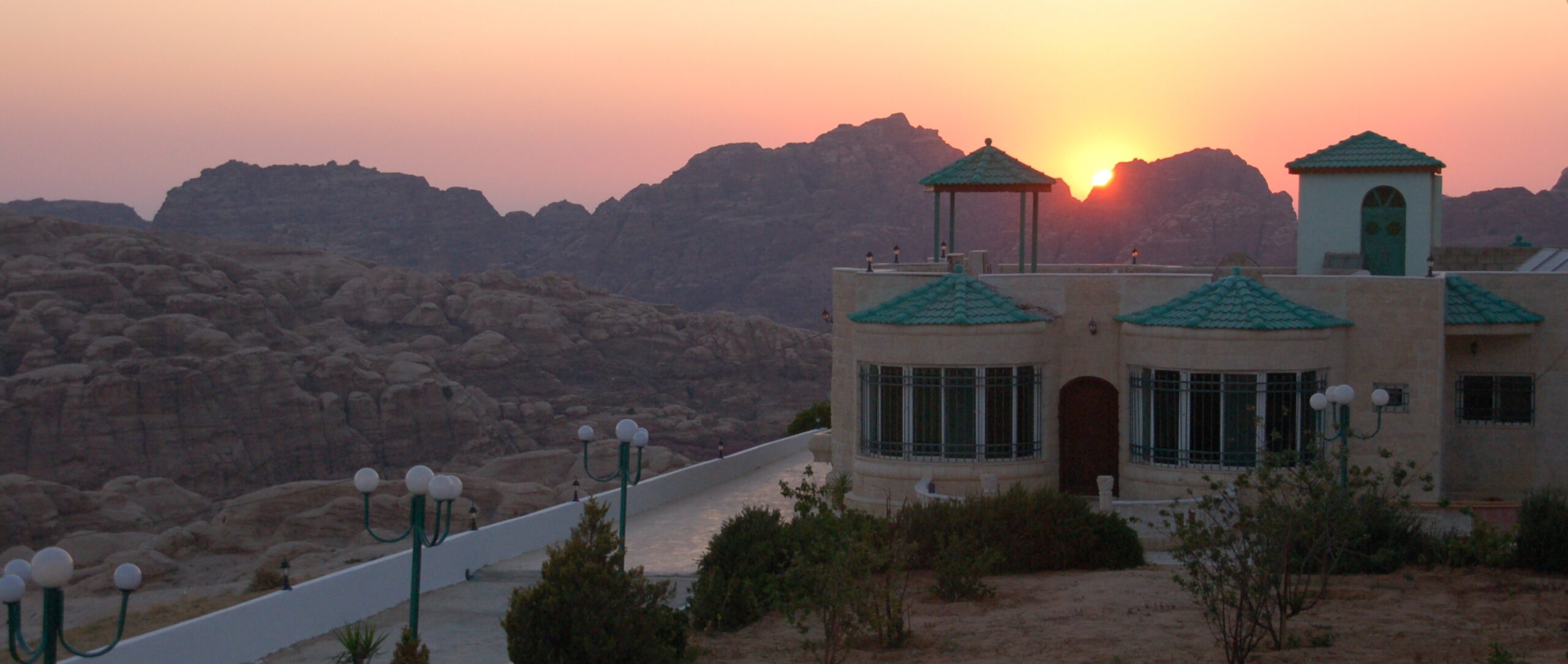 Sunset over the Petra mountains behind bed and breakfast Petra Fig Tree Villa